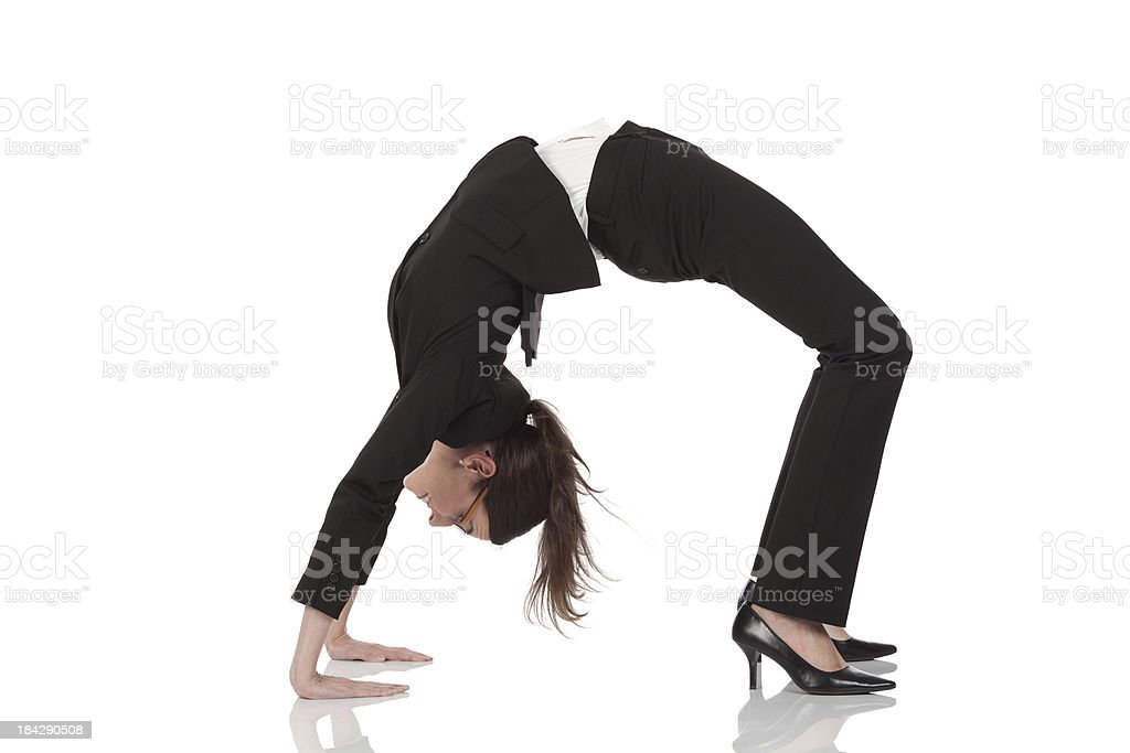 Businesswoman practicing yoga stock photo