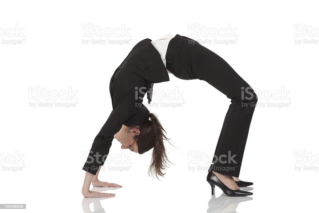 Businesswoman practicing yoga stock photo