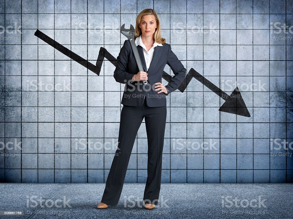 Businesswoman Prepared To Fix Downward Trend In Sales stock photo
