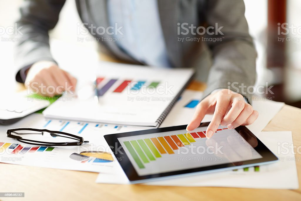 Businesswoman preparing profit report on digital tablet stock photo