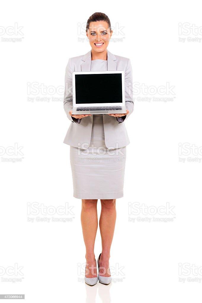 businesswoman presenting laptop stock photo