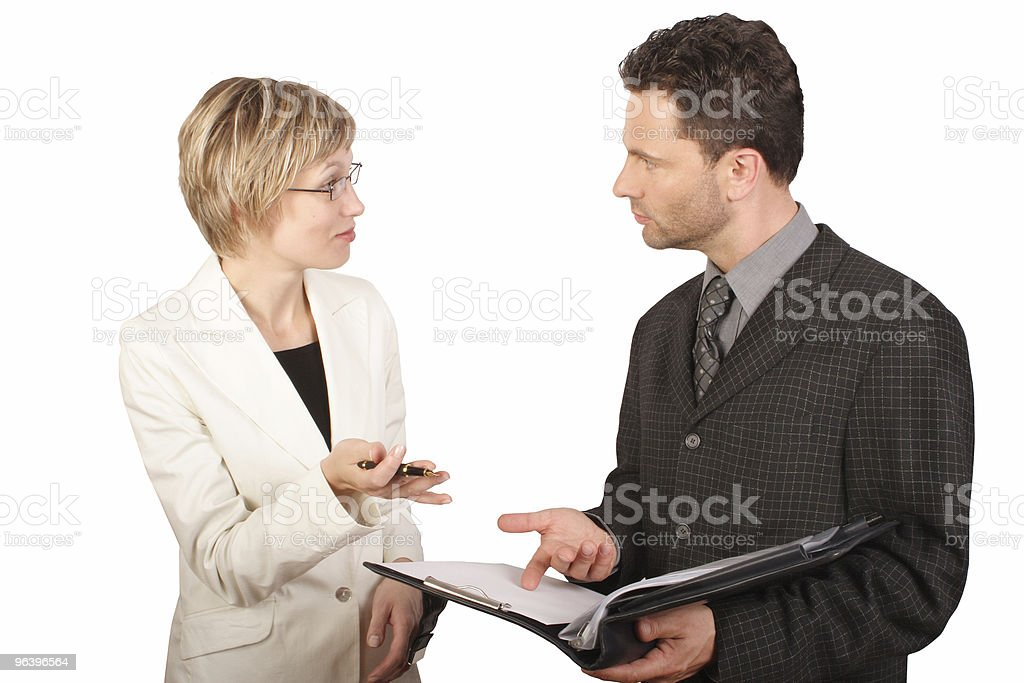 Businesswoman presenting report to  her partner royalty-free stock photo