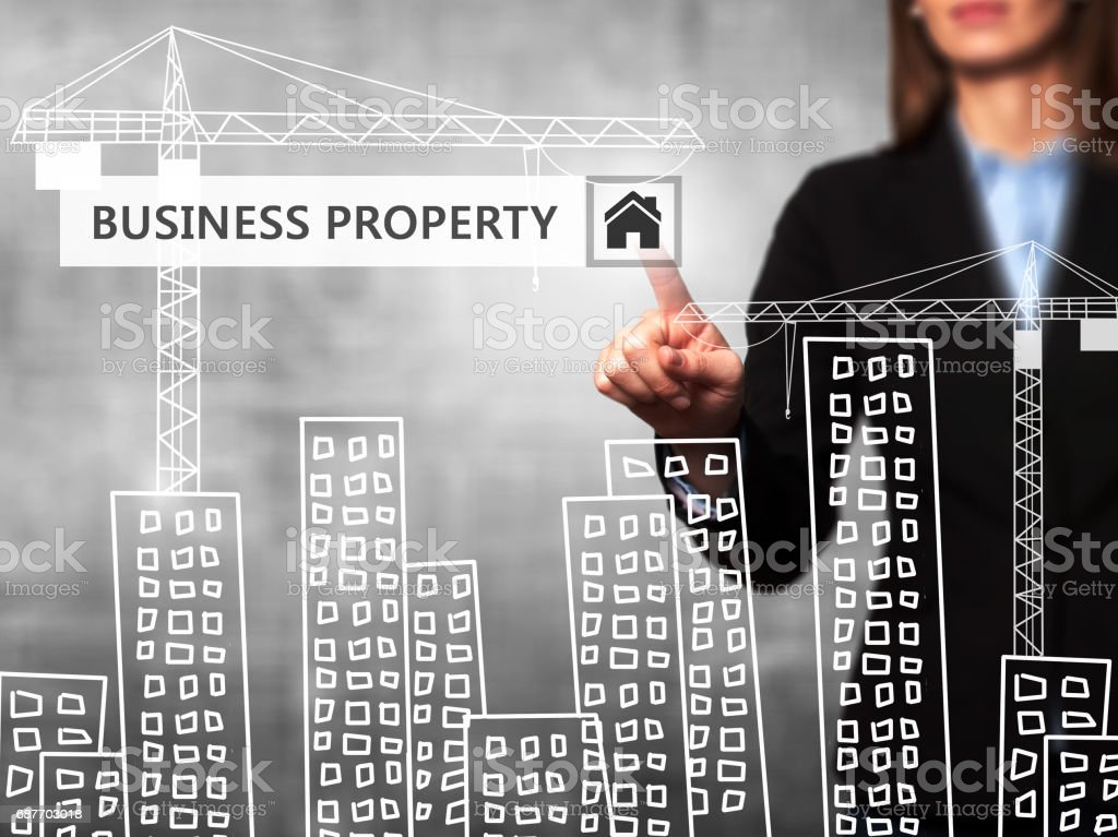 Businesswoman pressing business property button on virtual screens stock photo