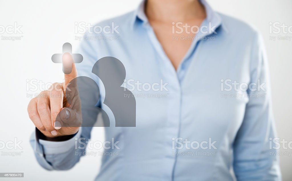 businesswoman pressing button on the digital touch screen stock photo