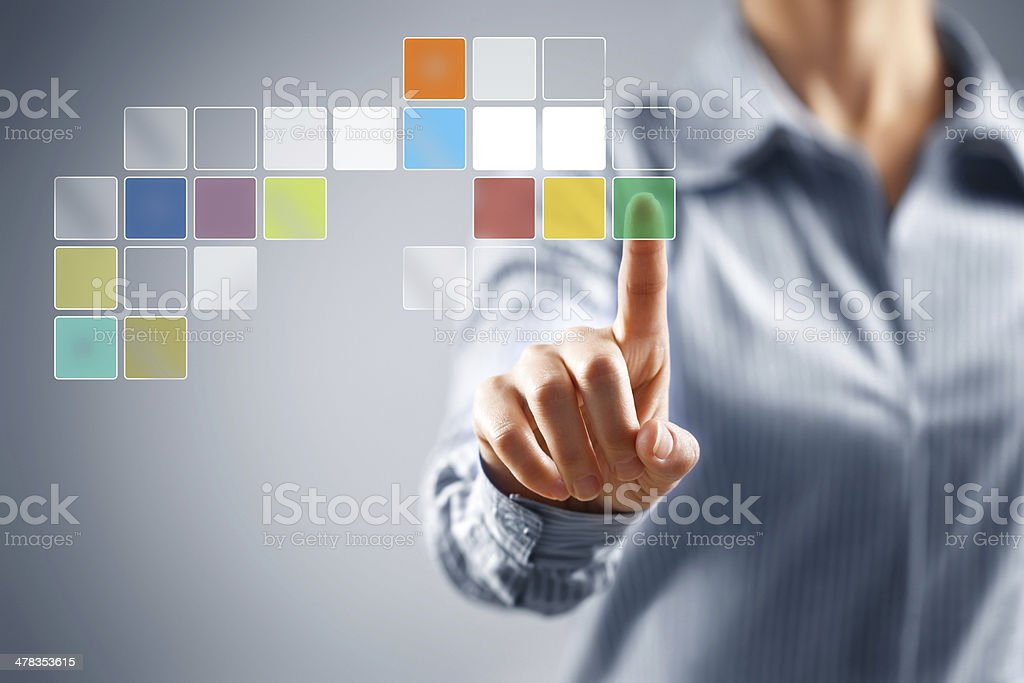 Businesswoman pressing button on touch screen royalty-free stock photo