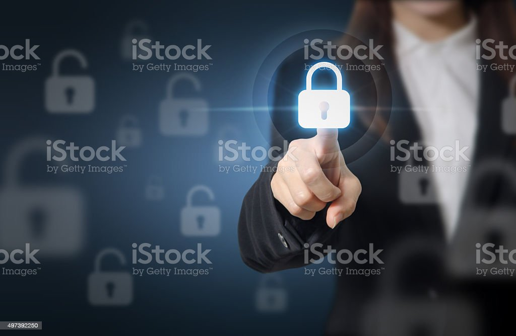 Businesswoman pressing security button. stock photo