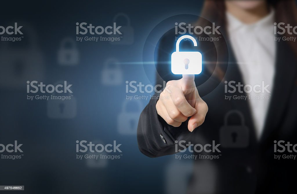 Businesswoman pressing unlocking on virtual screens. stock photo