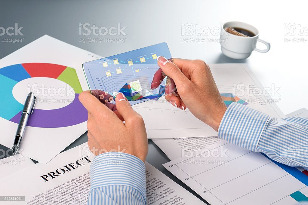 Businesswoman processing data on smartphone. stock photo