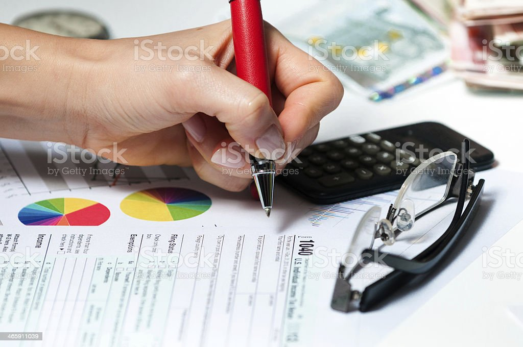 Businesswoman - professional financial expert filling IRS 1040 tax form stock photo