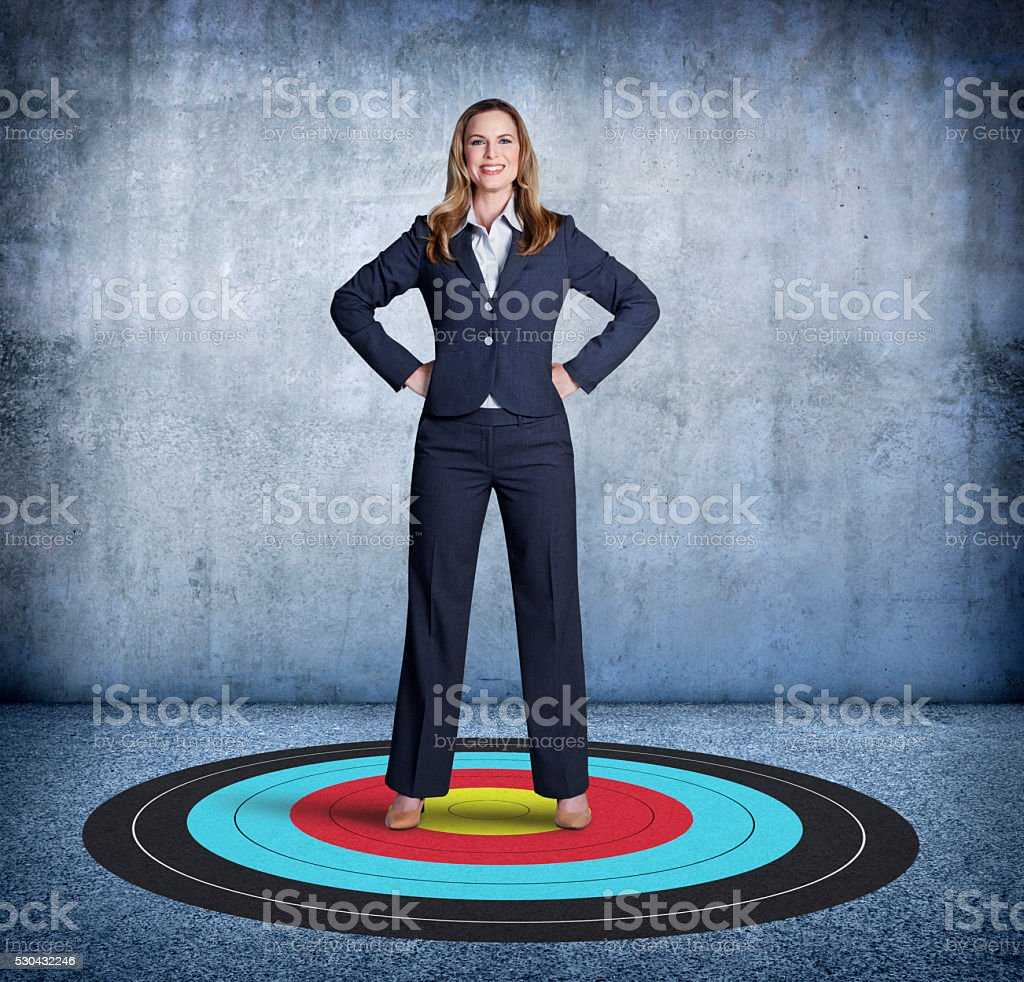 Businesswoman Proudly Standing On Top Of Her Target stock photo