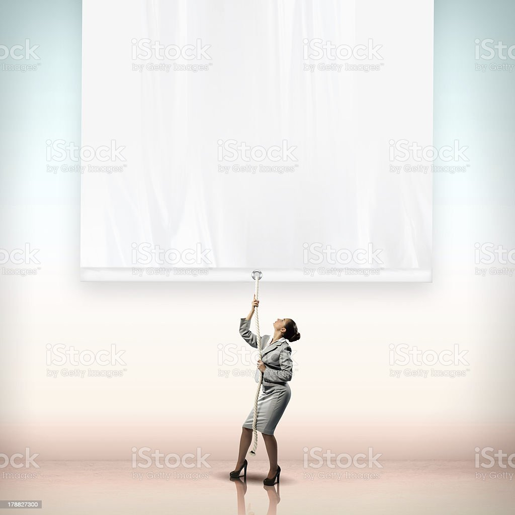 Businesswoman pulling banner stock photo