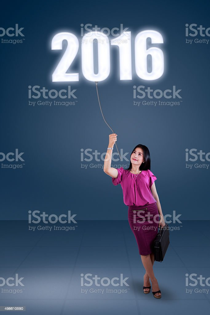 Businesswoman pulling down numbers 2016 stock photo