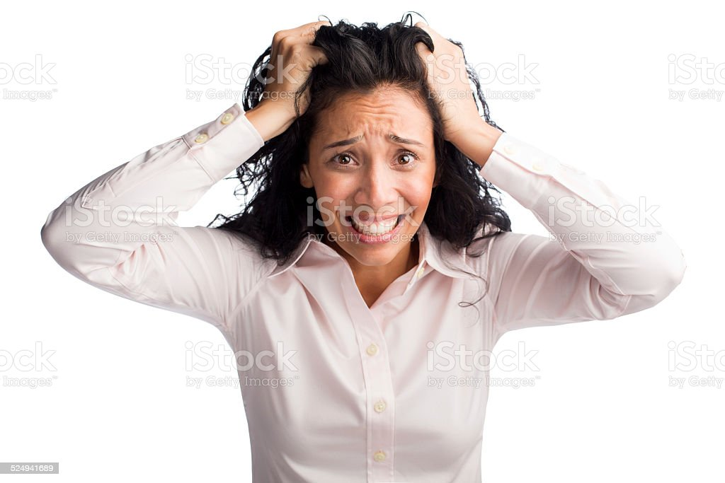 Businesswoman pulling her hair in frustration stock photo