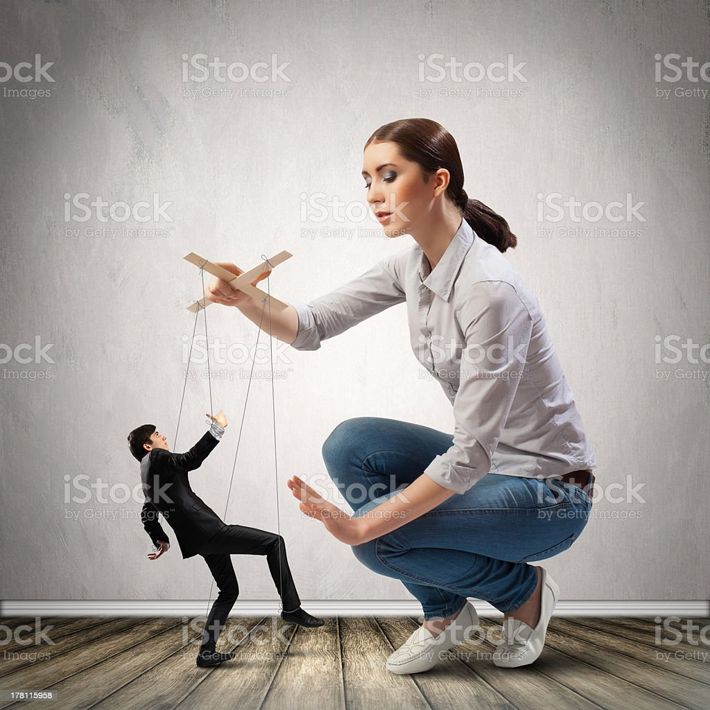 Businesswoman puppeteer royalty-free stock photo