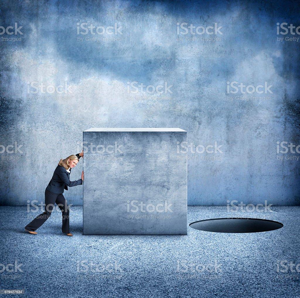 Businesswoman Pushes Square Block Towards Round Hole stock photo