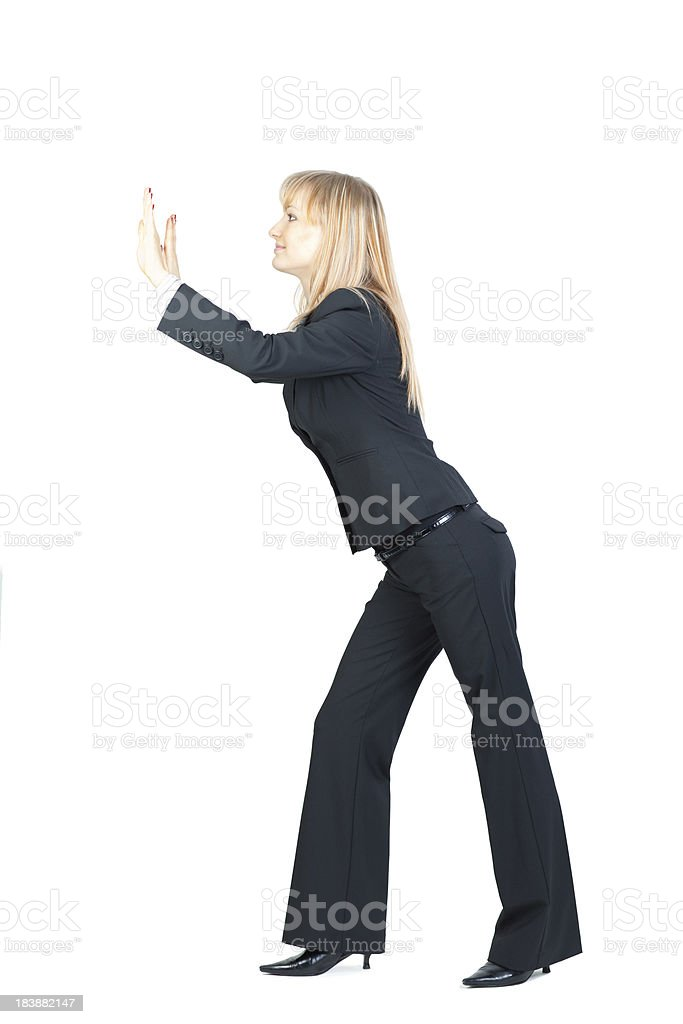 Businesswoman pushing something royalty-free stock photo