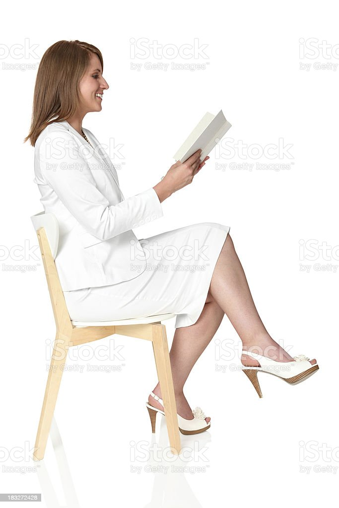 Businesswoman reading a book royalty-free stock photo