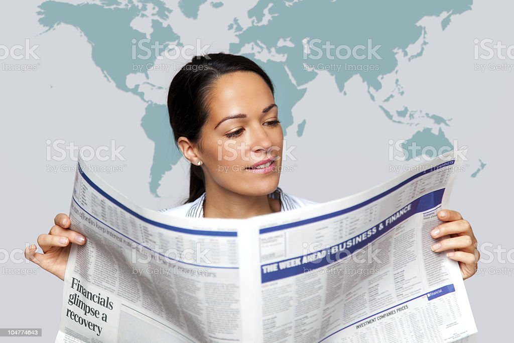 Businesswoman reading a financial newspaper stock photo