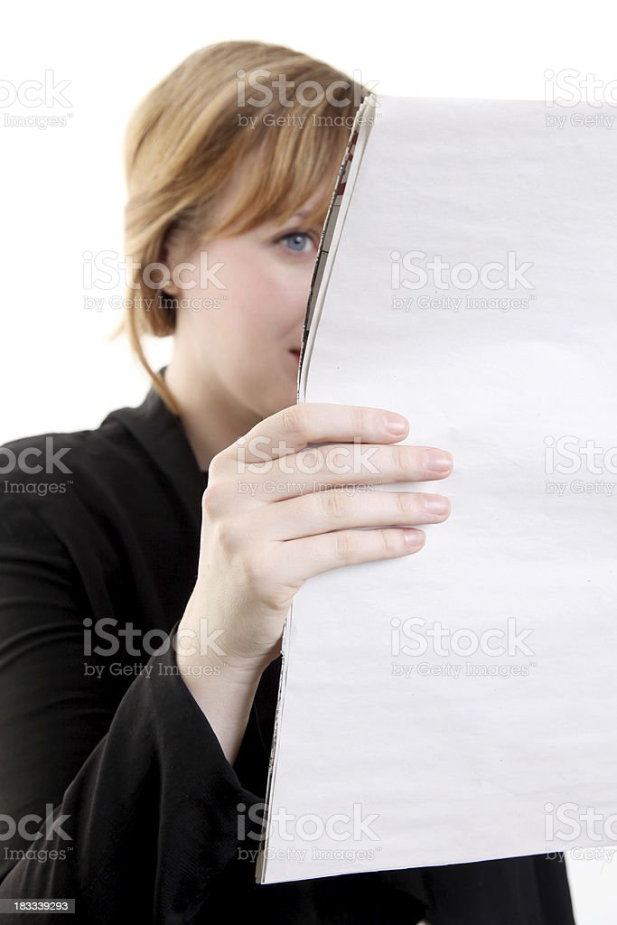 A businesswoman reading a large sheet of paper royalty-free stock photo