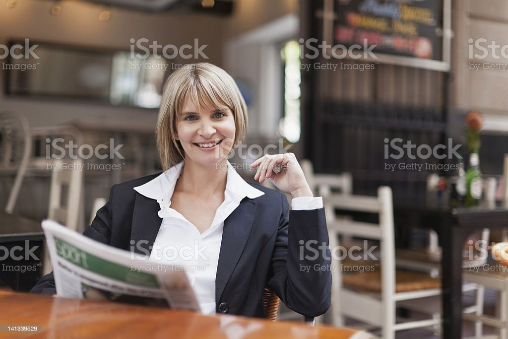 Businesswoman reading in cafe royalty-free stock photo
