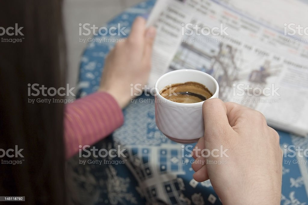 businesswoman reading newspaper royalty-free stock photo
