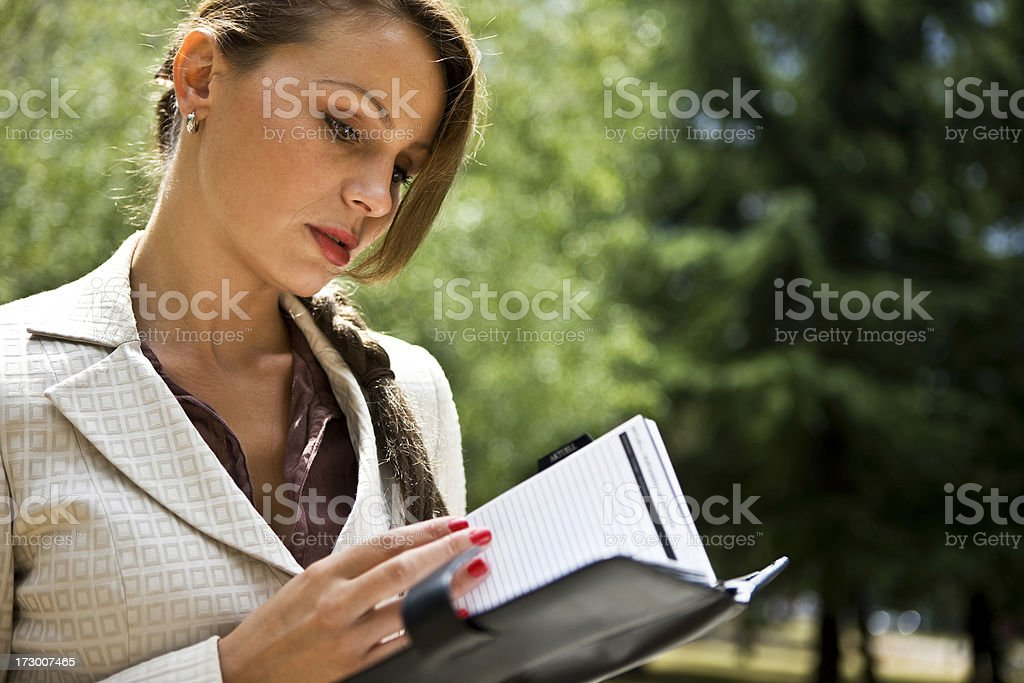 Businesswoman reading notes royalty-free stock photo