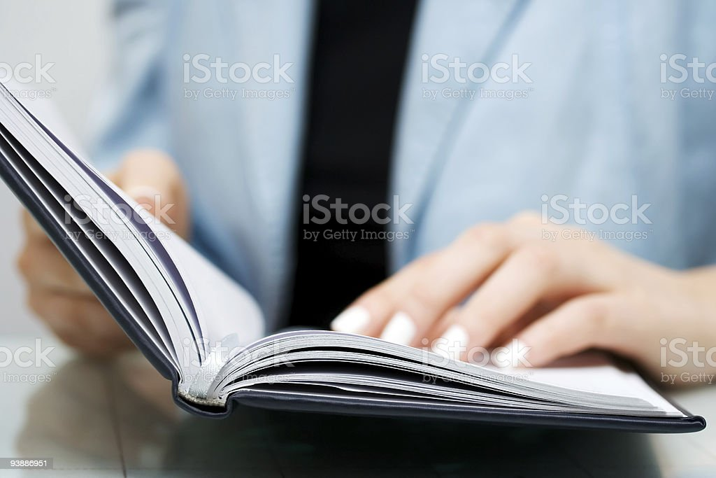 Businesswoman reading royalty-free stock photo