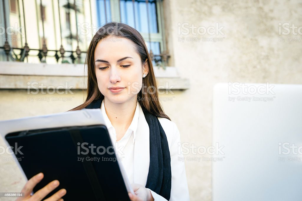 Businesswoman Reading Reports stock photo