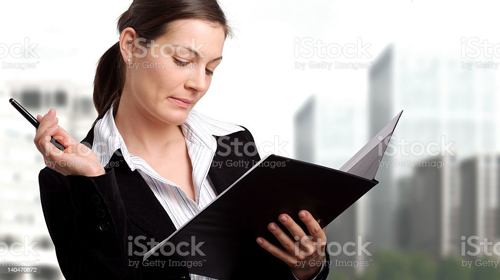 Businesswoman reads document royalty-free stock photo