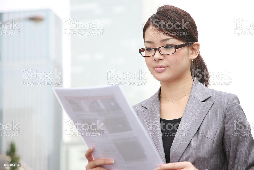businesswoman reads documents royalty-free stock photo