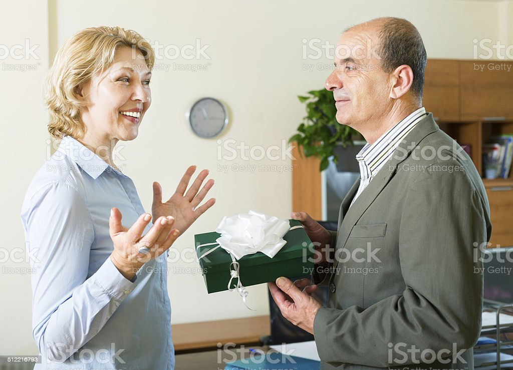 businesswoman receiving a gift stock photo