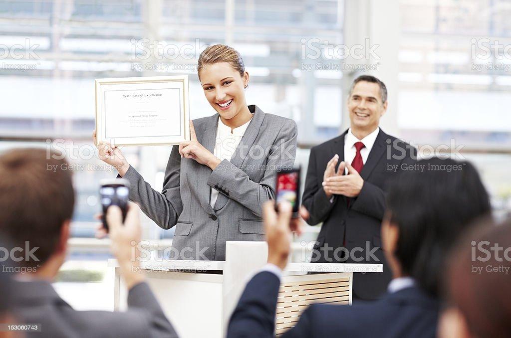 Businesswoman Receiving an Award royalty-free stock photo