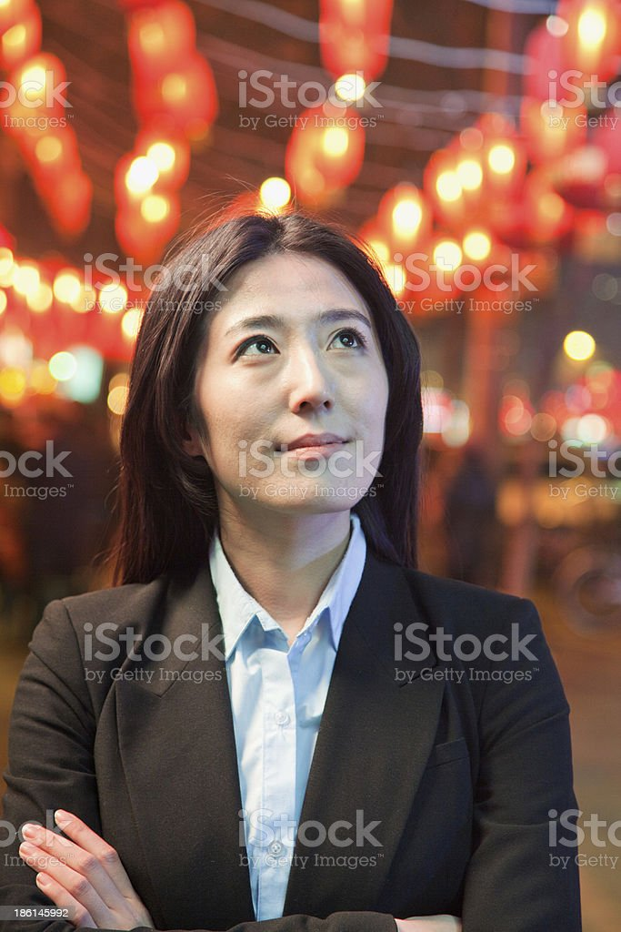 Businesswoman, red lanterns in the background royalty-free stock photo
