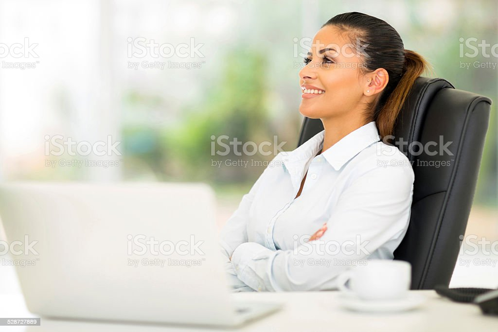 businesswoman relaxing at office stock photo