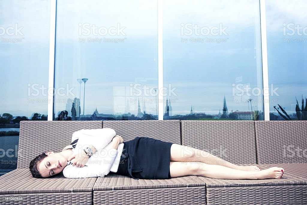 Businesswoman relaxing outside office stock photo