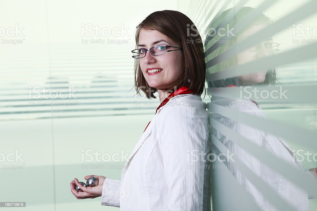 Businesswoman relaxing with chinese silver balls stock photo