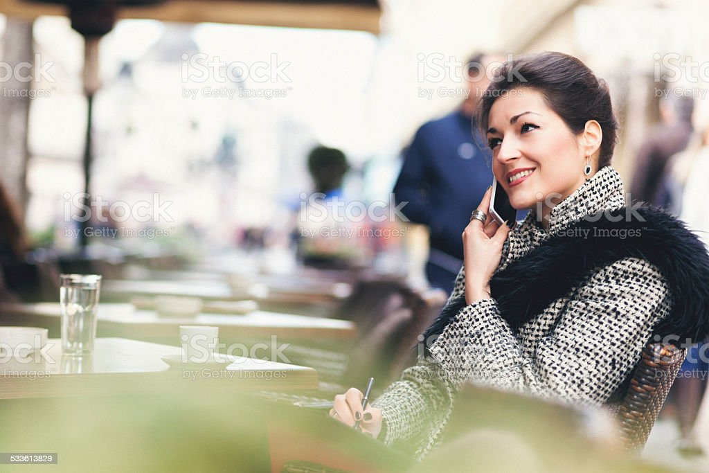 Businesswoman relaxing with coffee in a bar stock photo