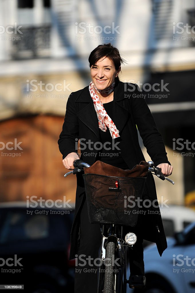 Businesswoman Riding Bicycle Paris France royalty-free stock photo
