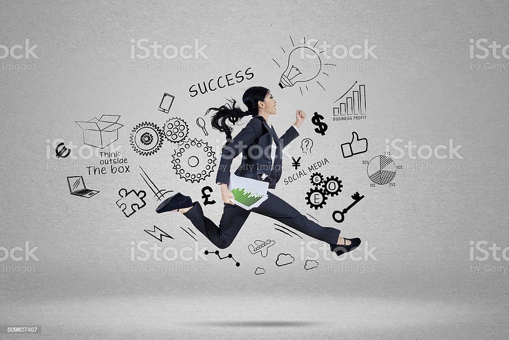 Businesswoman running for chasing her target 1 stock photo