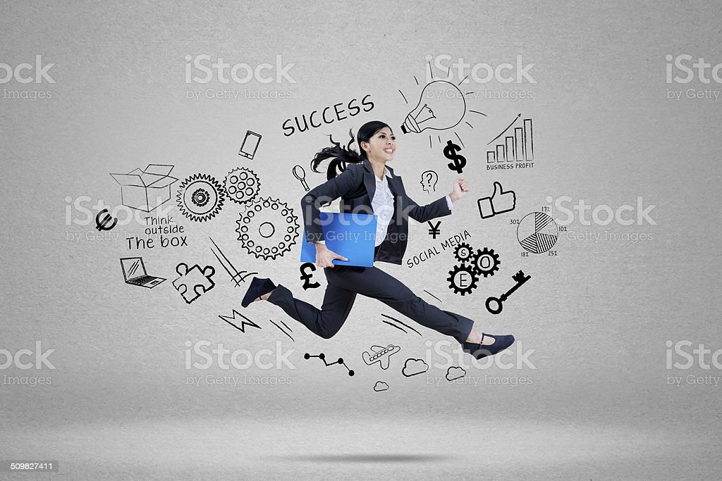 Businesswoman running for chasing her target stock photo