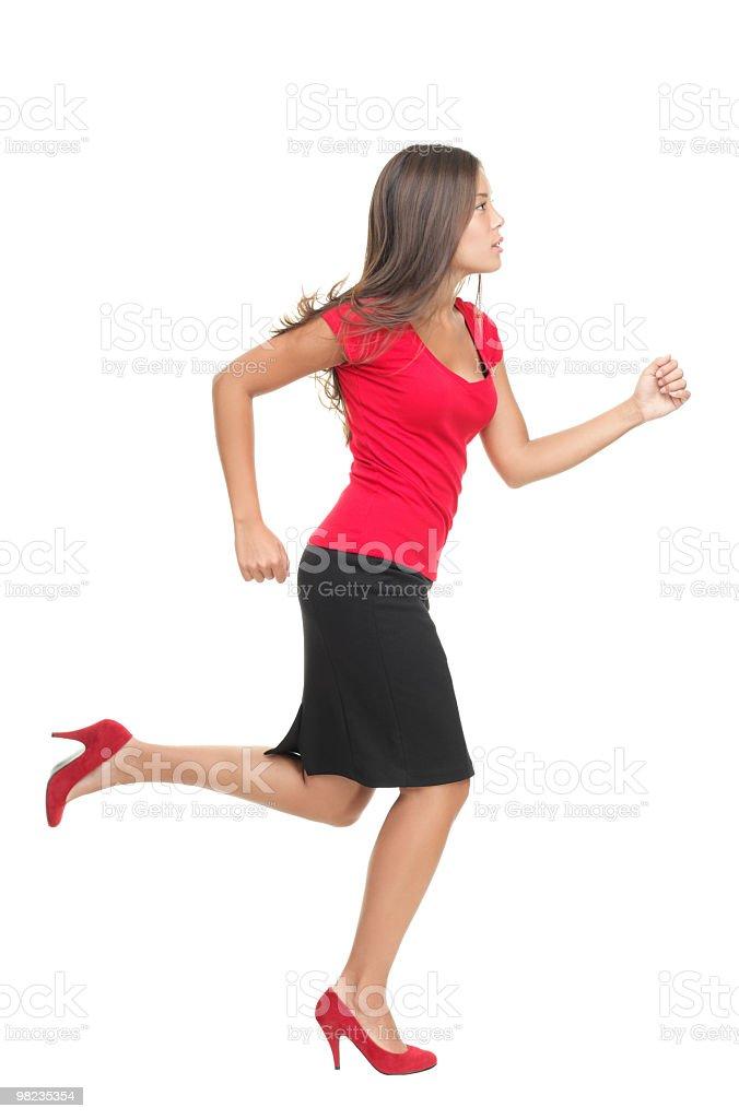 Businesswoman running isolated on white background stock photo