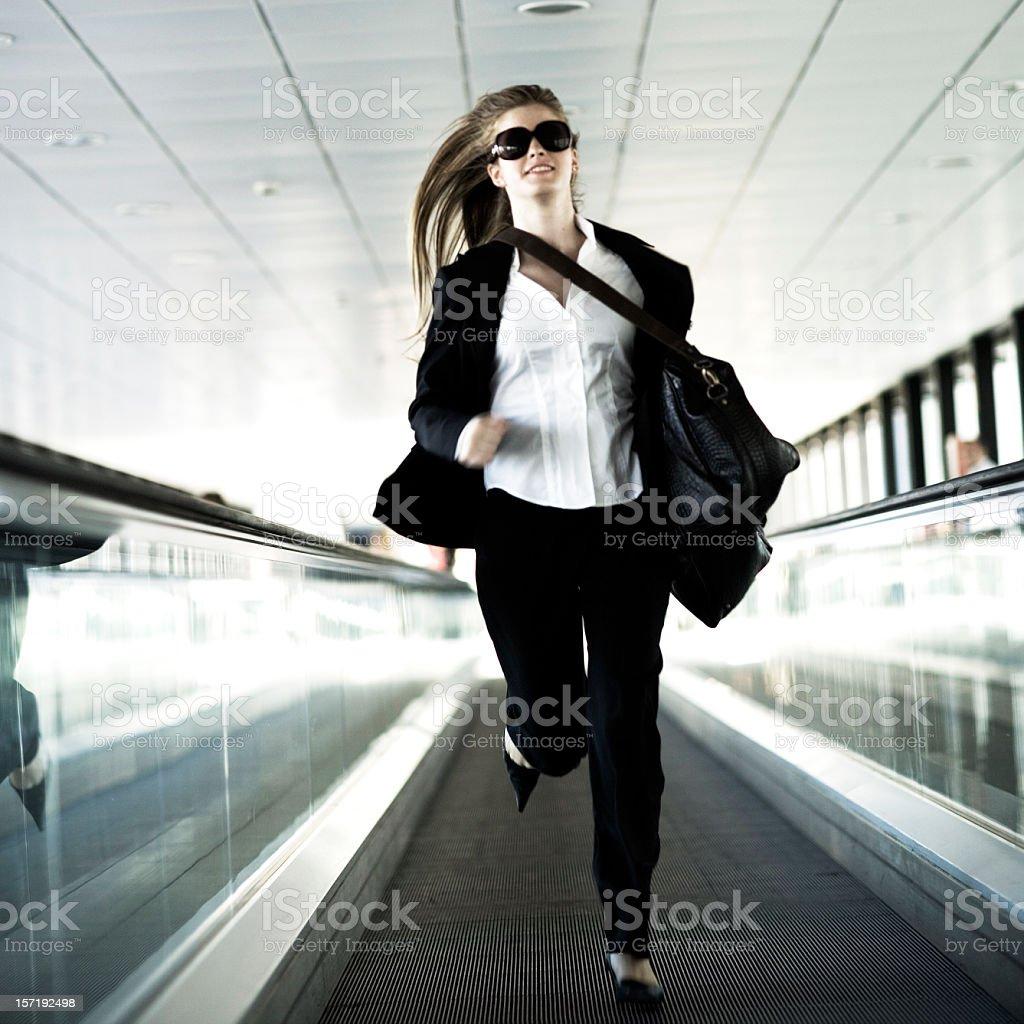 businesswoman running moving stairway royalty-free stock photo
