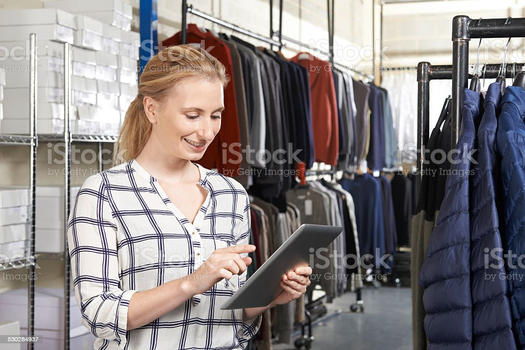 Businesswoman Running On Line Fashion Business With Digital Tabl stock photo