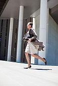 Businesswoman running outdoors