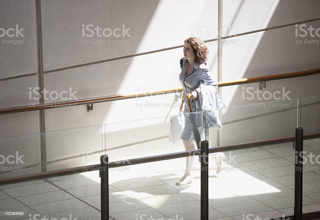 Businesswoman rushing up ramp royalty-free stock photo