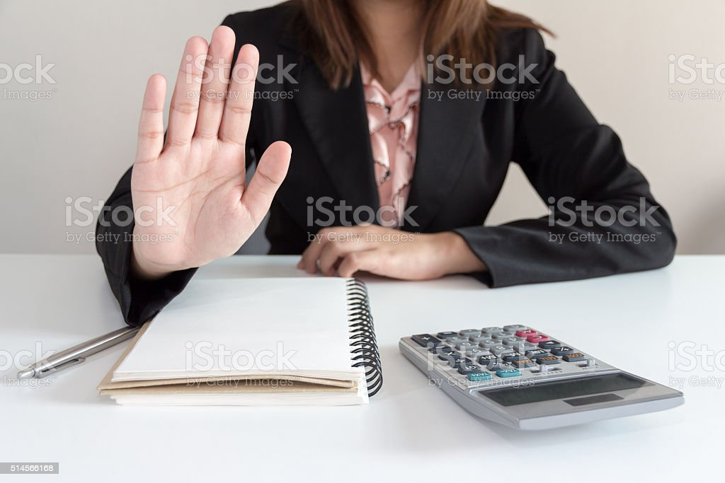 Businesswoman says no at her office stock photo