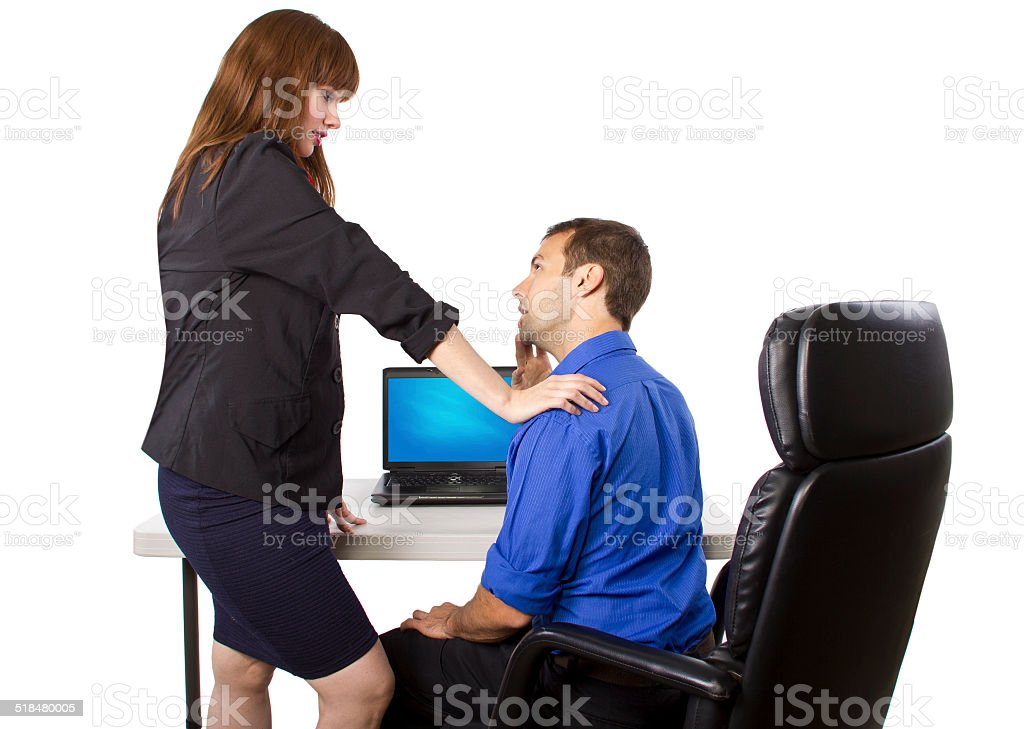 Businesswoman Seducing a Businessman in the Office stock photo