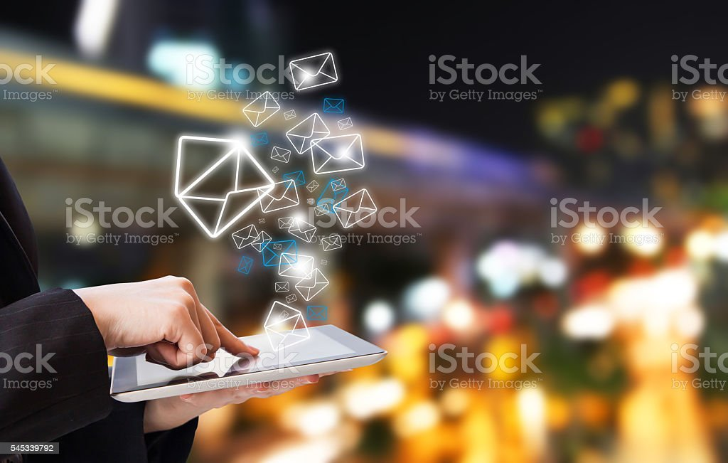 Businesswoman sending email marketing stock photo