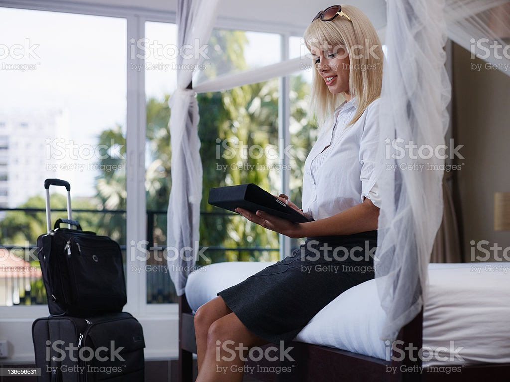 businesswoman sending email on touch pad computer royalty-free stock photo