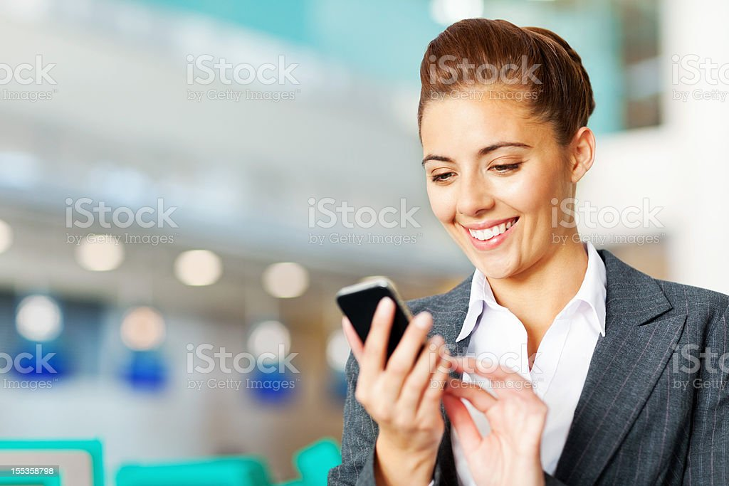 Businesswoman Sending Text Message royalty-free stock photo
